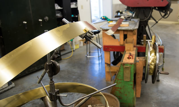 This press has been thump-thump-thumping out brass spoons since Len Thompson purchased it used in 1946.