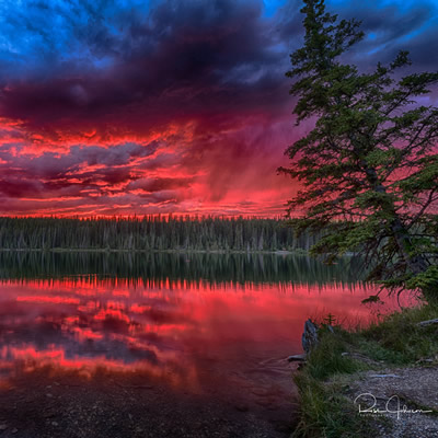 One of Ross Johnson's photographs: Fish Lake at sunset with a dramatic red sky