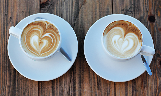 two cups of coffee at a coffee shop