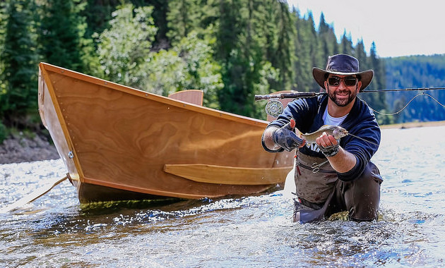 Adriano Lafauci with his catch. Antique wooden drift boats provide the perfect transportation as guests drift down the river. In day trips, guests can expect about six stops to fish the pools along the way.