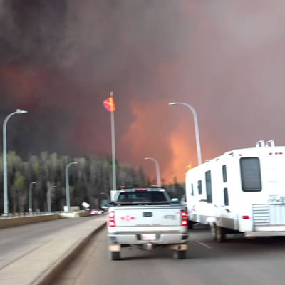 A YouTube photo of a Fort McMurray resident escaping the burning city with trailer in tow.
