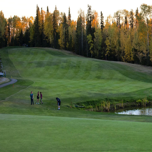 This hole on the Poplar Hills Golf & Country Club in Fort Nelson is lined with trees and has a water hazard.