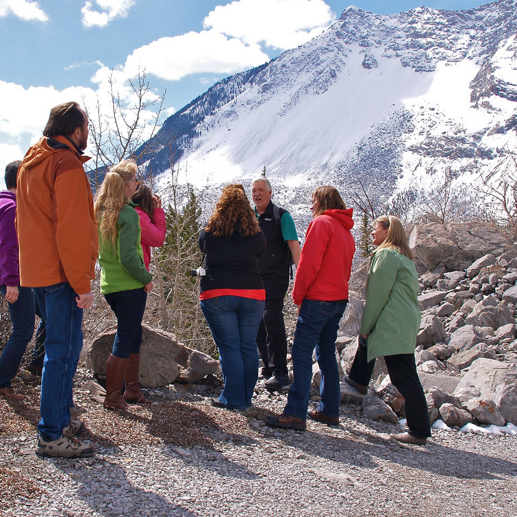 Hikers touring the Frank Slide site with a guide