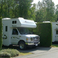 Photo two parked RVs