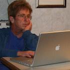 Woman using an Apple computer
