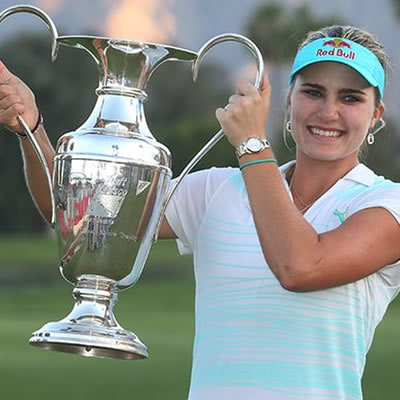 Picture of woman holding golf trophy.