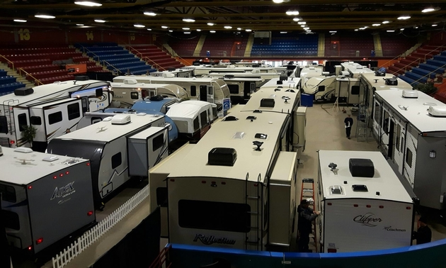 A large showroom with brand-new RVs