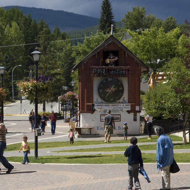 A huge cuckoo clock in Kimberley BC, with people standing around it