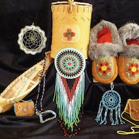 A display of native items, including  beaded moccasons, a miniture canoe, dreamcatcher and a beaded purse  from the Mackenzie Crossroads Museum and Visitor centre at High Level.