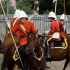 Men on horses perform a musical ride.