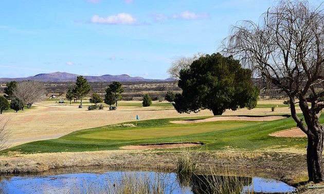 The par 3 third hole requires a shot over water.
