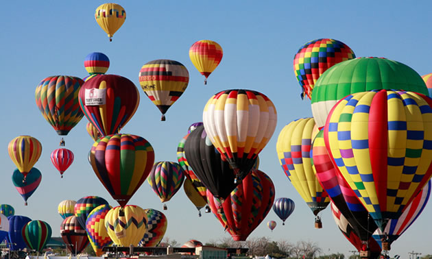 Pictured here is a sky full of colourful hot-air balloons at the International Balloon Fiesta in Albuquerque.