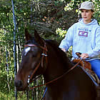 woman riding a horse in Jamieson Woods Nature Preserve