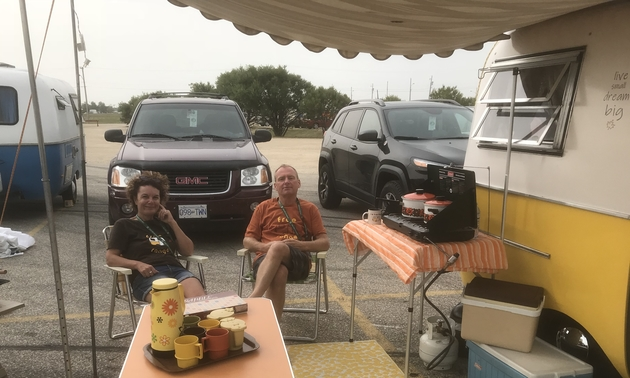 The Sietzemas sitting in front of their Boler