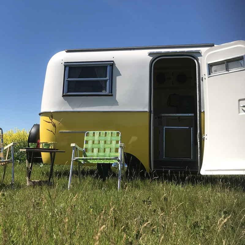 yellow boler with lawn chairs in front
