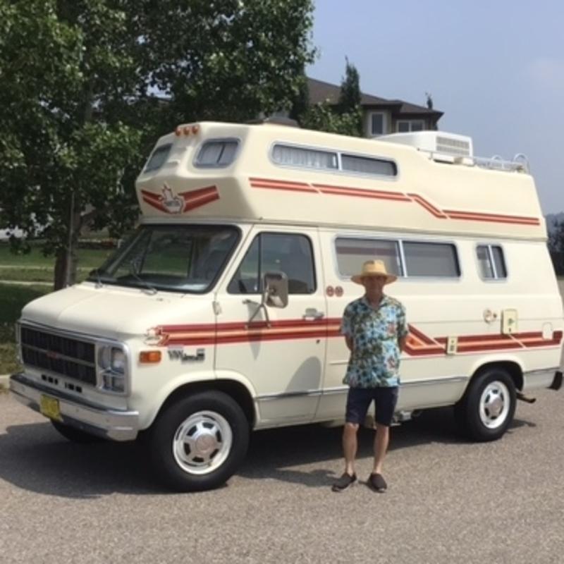 Randy Welsh standing in front of his vintage camper van