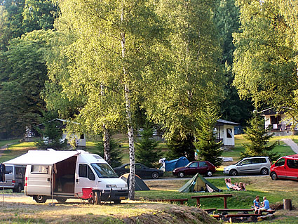campground with RVs and people in it