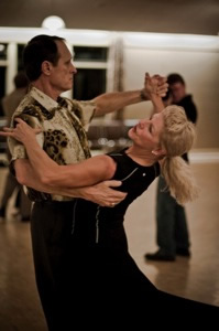 A man and a woman are dancing together.