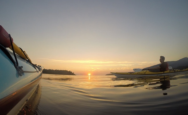 Out on the water at sunset with Bowen Island Sea Kayaking.