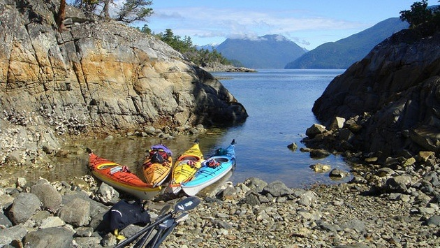 Kayaks are rafted together in a sheltered bay on an island just off of Lund.