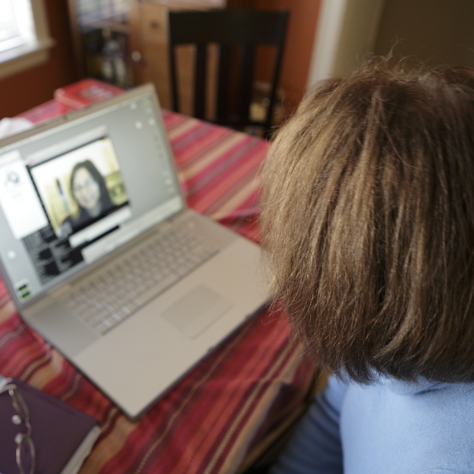 child talking on Skype to a family member