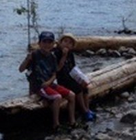 We have a 28' 2014 Springdale travel trailer, and one of our favourite places to visit is Kootenay Lake. My older son loves to fish while his younger brother loves to lend his moral support. Here they are taking a break from fishing long enough to pose for a photo.