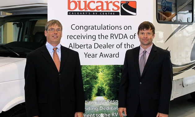 Kyle and Jeff Redmond in the Bucars showroom.