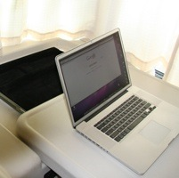 Photo of a laptop on a countertop of an RV.