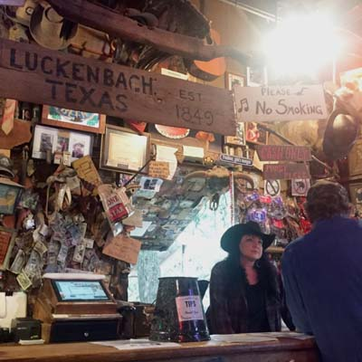 A bartender takes an order at The Luckenbach Bar in Texas.