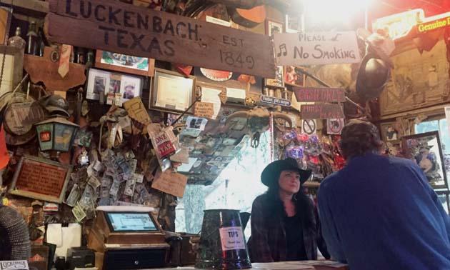 A bartender takes an order at The Luckenbach Bar in Texas.
