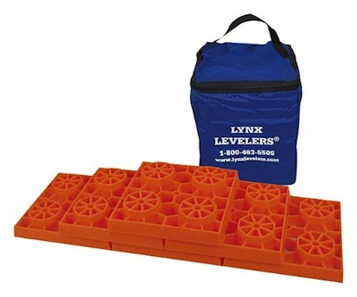 Orange plastic RV levelers with carrying bag