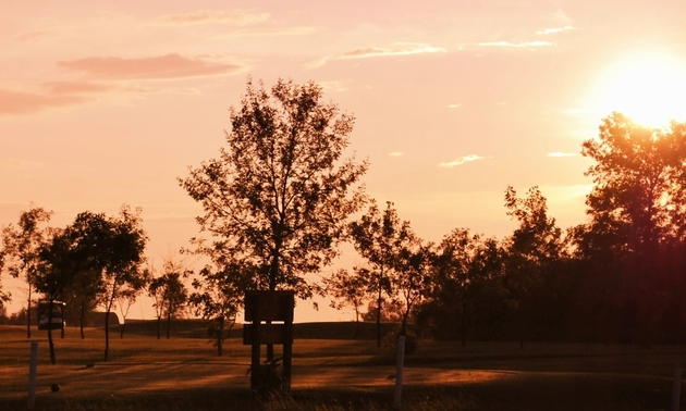 Shown is a sunset over the Manitou Beach Golf Club in Manitou Beach, Saskatchewan.