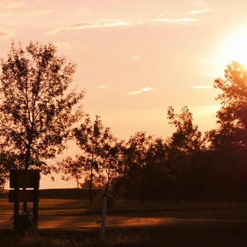 Shown is a sunset over the Manitou Beach Golf Club in Manitou Beach, Saskatchewan.