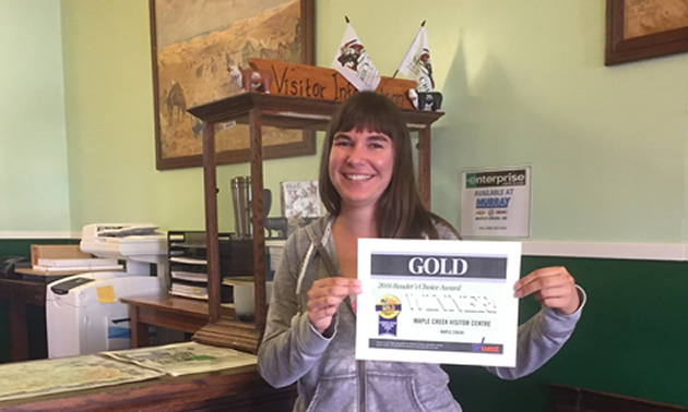 Picture of woman holding RVwest award certificate.