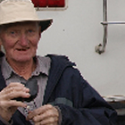 man sitting behind an RV