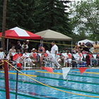 people around a swimming pool