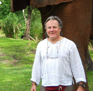 Mike Donovan standing in front of an Elephant.