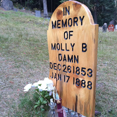 The Molly B Damn grave has a new simple wooden grave marker.