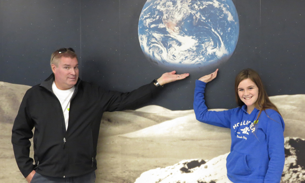 Haley and Glyn hold the whole world in their hands at Pima Air and Space Museum.