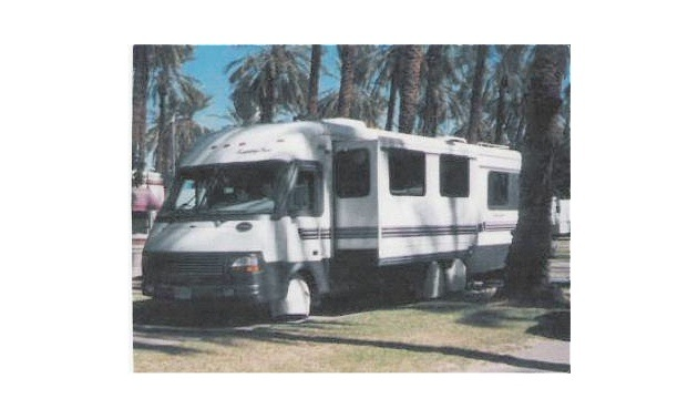 A motorhome with the awning up.