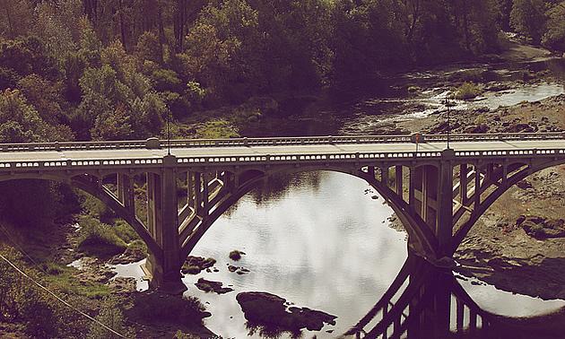 river flowing underneath a bridge