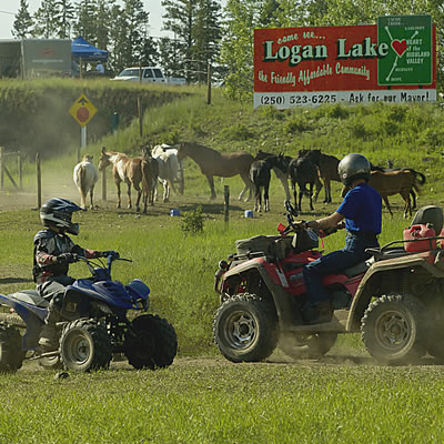Two people on ATV's.