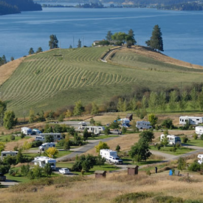 Picture of RVs on hillside overlooking lake.