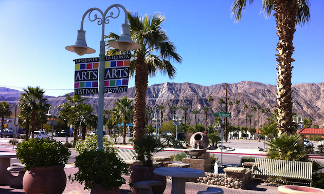 Palm trees, mountains and banners