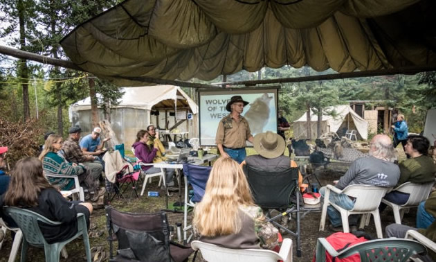 Ross Hinter is giving a presentation about the wolves of Western Canada at Rat Root Rendezvous, an annual primitive skills gathering held by Karamat Wilderness Ways near Wildwood, Alberta, every August.
