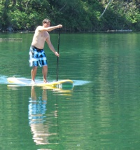 A man on a paddleboard.
