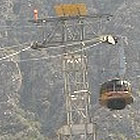 tram passing over a mountain
