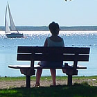 Person sitting on a dock