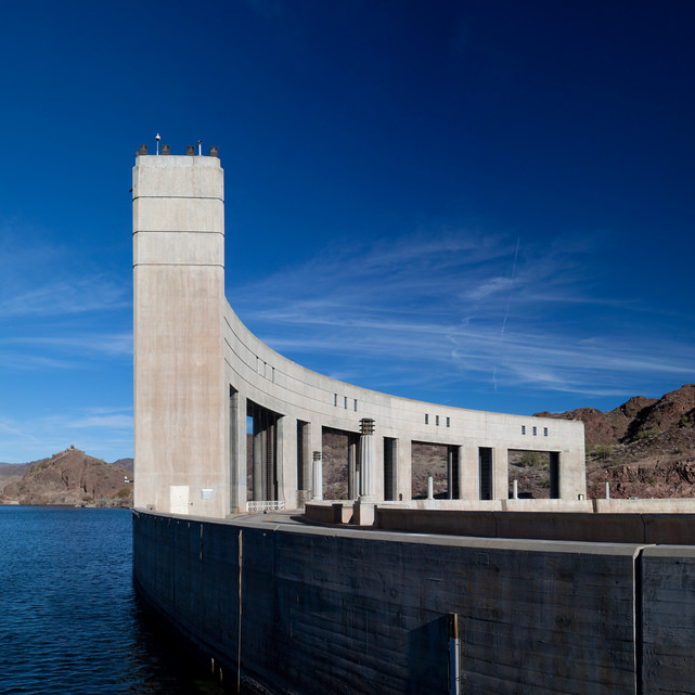 This is a photo of the Parker Dam with blue sky and the blue waters of Lake Havasu.