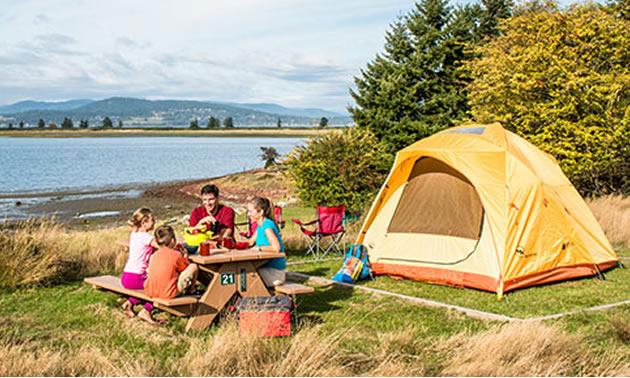 Family camping along a lakeshore.
